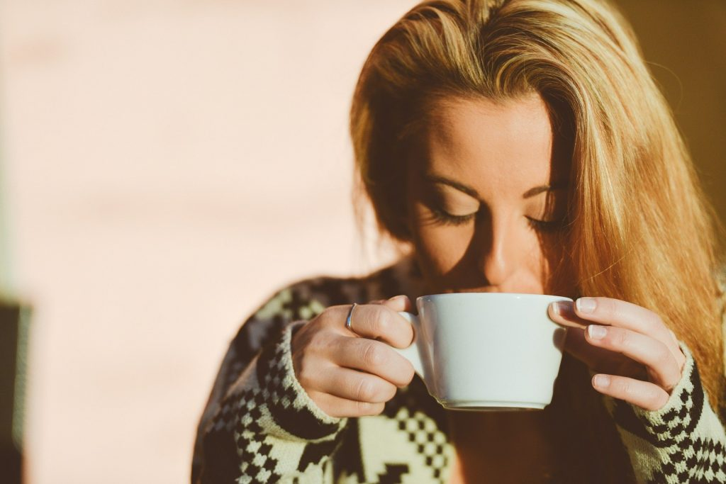 Female drinking coffee